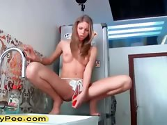 Blond teenager toy and piss