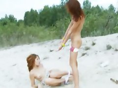 Sensual russian gals toying on the beach