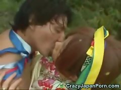 Jap Lady Caresses a Papuan!
