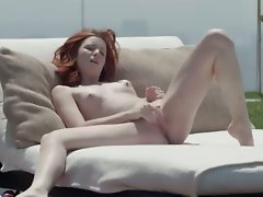 Lovely redhead opening pussy outside