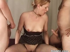 Alluring vixen strokes pecker while another part1