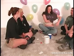 Teenager girls kissing in truth or dare game