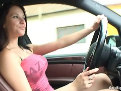 Chesty dark haired car driving