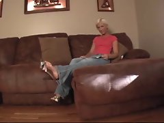 Blond models in jean dangles her feet