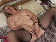 Experienced experienced cheating wife playing on her bed