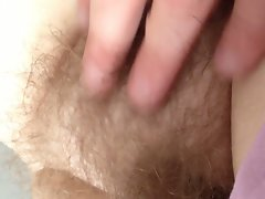 close up of her very hairy pussy.