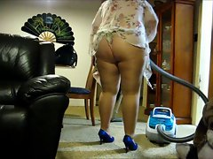 vacuuming the living room in pantyhoses
