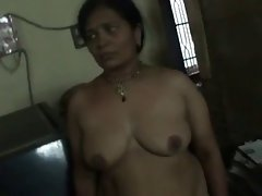 Randy indian aunty changing her dress-video1