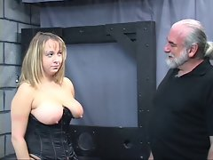 Experienced man dom pulls buxom sub's hair and smacks her large melons