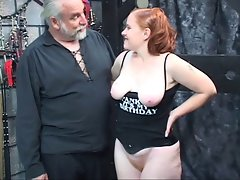 Redhead bitch Kirsten caresses her master's penis then gets banged and spanked