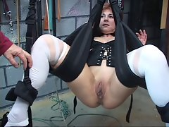Cute, experienced redhead gets her sexy fanny toyed with in a sex swing