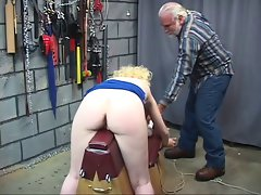 Blond slave gets her butt smacked while stroking her master's prick