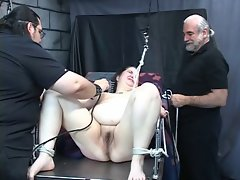 Heavy vixen gets tortured by older fellows in the dungeon