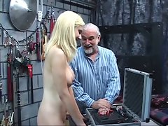 Bondaged blondie must hold vibrating sex toy to her pussy as elder dude clamps her nipples