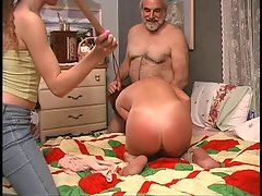 Vixen gets down on the bed and chap spanks her rough with wooden paddle