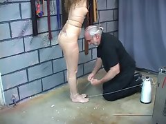 18 years old dark haired slave has er niples bound with string.