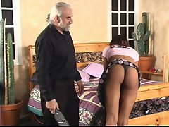 Experienced chap lifts ebony's skirt for mad spanking