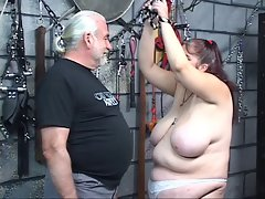 Heavy titted plumper bdsm dark haired gets caned and whipped by master