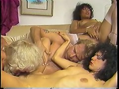 Curly hair dark haired Kim Carson gets her vagina fondled in 80s orgy