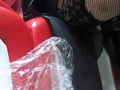 Babe in stockings changing her shoes in a shoe shop