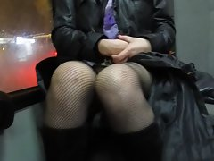 Lass in fishnet stockings flashing muff in a bus