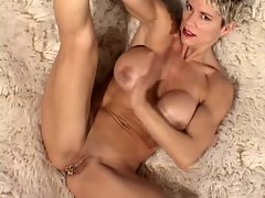 Buxom Cougar with 15 vagina piercings