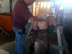 nympho chained to Saw Hooters Heels Stockings Spank BDSM