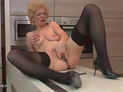 Ugly attractive mature nympho loves to masturbate in her kitchen