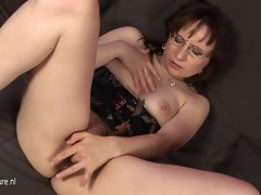 Alluring bushy experienced stepmom playing with herself