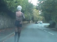 Shemale Tart in public - skirt too short to hide her phallus