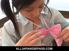 Seductive teen bombshell Ren Kikukawa in a school uniform stroking pecker