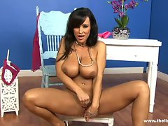 Blistering Lisa Ann delights toying her lush dripping snatch