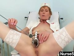 Older mother self exam on gynochair with speculum