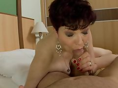 Sensuous granny spreads her dripping lips round a solid cock