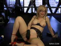 Blistering Nina Hartley fingers her moist cunt hole