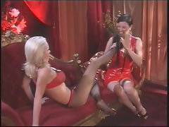 Tempting Anastasia Pierce caresses Nikki Benz' feet