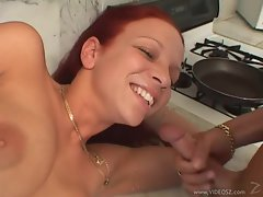 Saucy redhead Brandi May gets her face drenched in cum