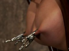 Charisma Capelli has her raunchy nips clamped