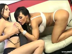 Sassy Lisa Ann caresses Lassie Martinez' massive knockers