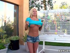 Attractive as hell Nikita Von James displays her massive melons
