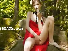 Glass fake penis in her girly pussy in forest