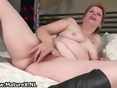 Experienced mama laying on the bed and rubbing part4