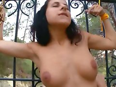 Fascinating lesbos fingering in a grass