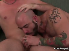 Two gay chaps have fun stroking solid cock part2