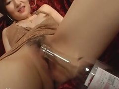 Bottle and phallus in her Jap butthole