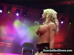 Big breasted Light-haired in net panties gives a live rubber toy show on stage