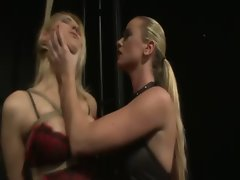 Blond LEZDOM skank playing with her light-haired tied down slave