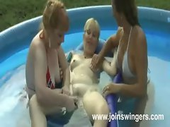Attractive mature lesbo toying in the garden
