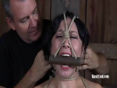 A spreader bar is all it receives to lay Nyssa out and keep her legs opened wide.