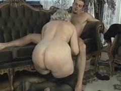 Experienced blond nympho rides shaft in group sex